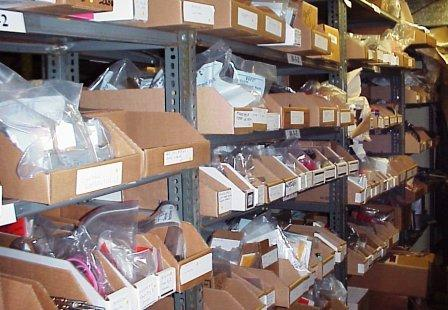 A storage room stocked with parts for commercial laundry equipment