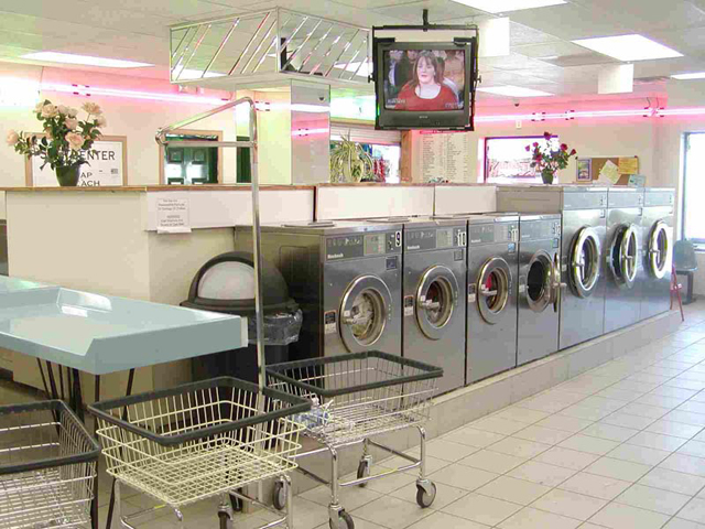TV's & Neon add visual Beauty to this Laundromat Thumbnail